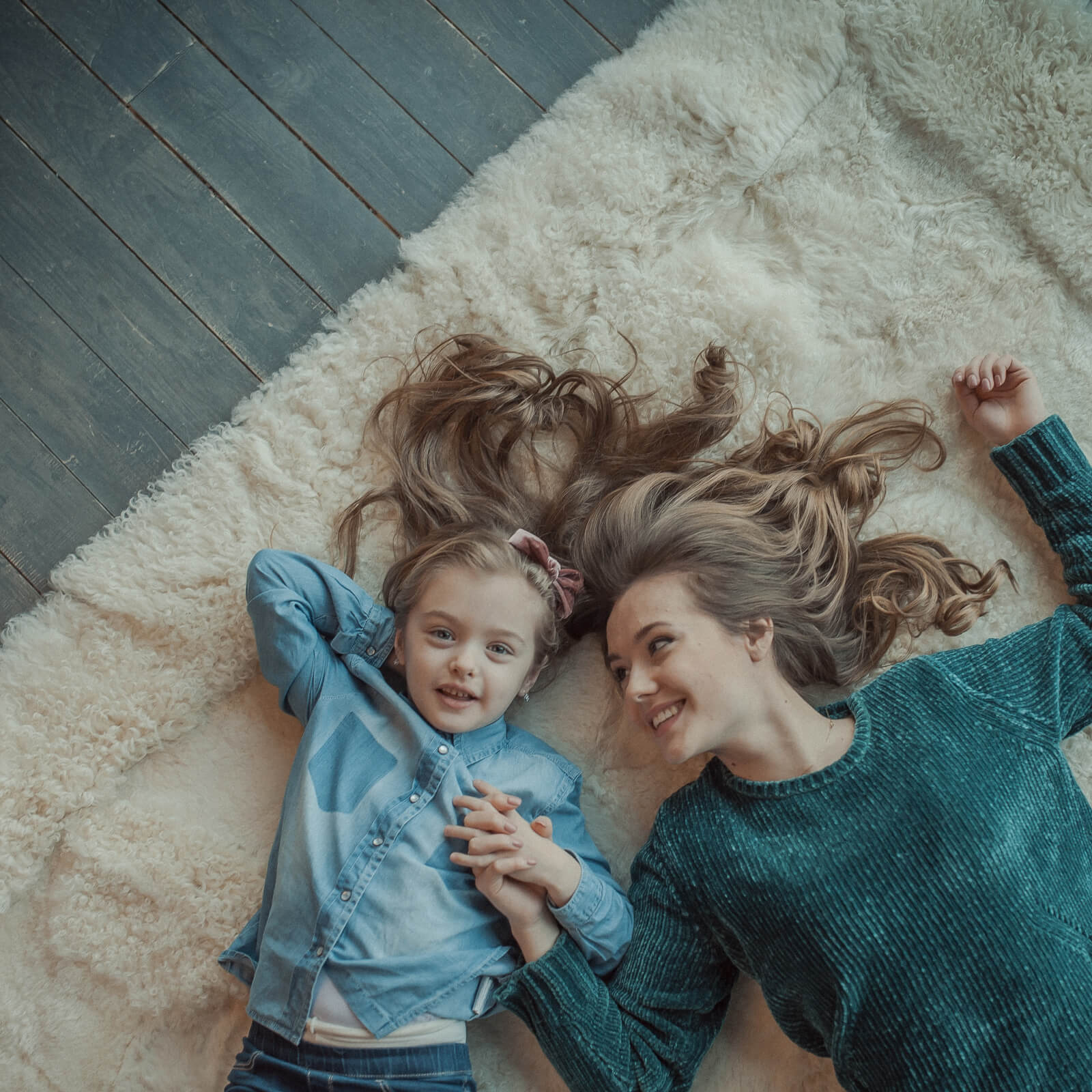 Mom child on plush rug | McCool's Flooring
