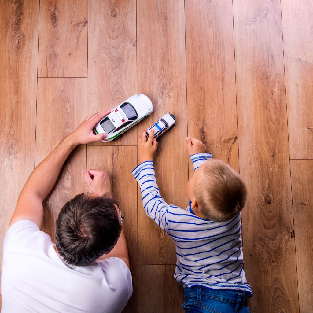Father with kid playing with toycar